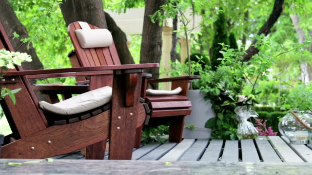 garden wooden furniture on the terrace of the house - формальный сад стоковые видео и кадры b-roll