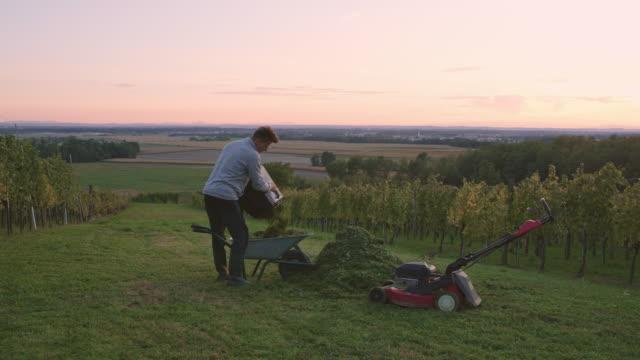 WS Gardener emptying a grass catcher of a mower video