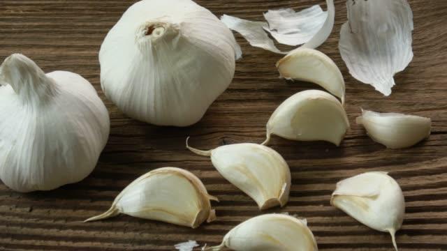 Garlic bulbs. Fresh garlic on the wooden table. - video