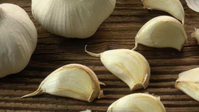 Garlic bulbs. Fresh garlic on the wooden table. video