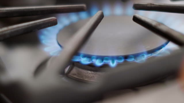 gas burner on a household stove - fornello video stock e b–roll