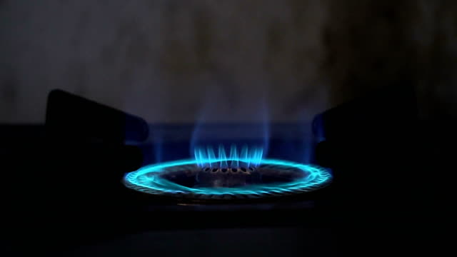 Gas fire from gas stove,Blue flaming from gas oven. video