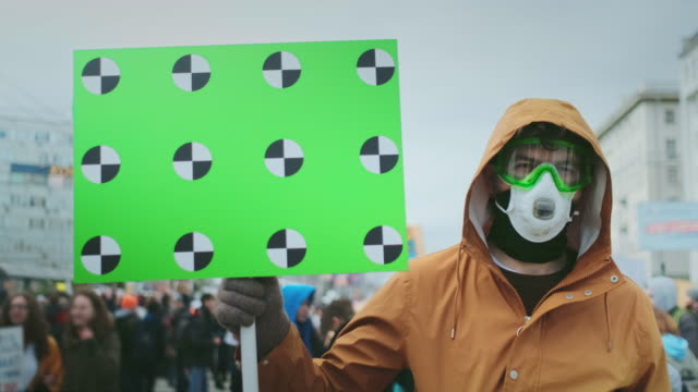 Gas mask rebel face portrait. If you enter hold banner in hand. Gas mask resistance. video