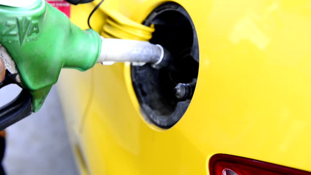 Gas Nozzle out of Car Gas Nozzle out of Car handle stock videos & royalty-free footage