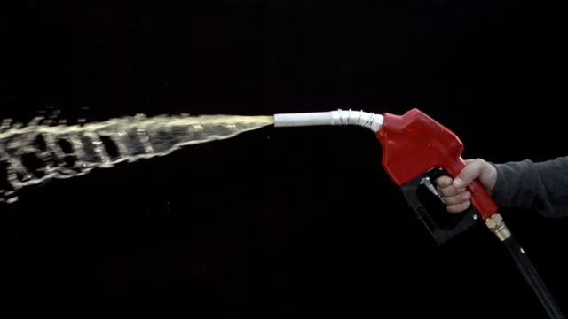 Gas nozzle spraying on black background, slow motion video