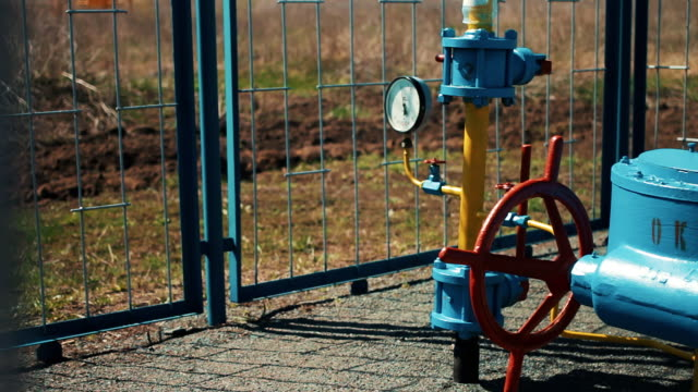 Gas pipe with manometer. Large red shut-off valve. Supply of natural gas to the public. Station for pumping and transportation of gas. Cleaning and storage. Oil and gas industry video
