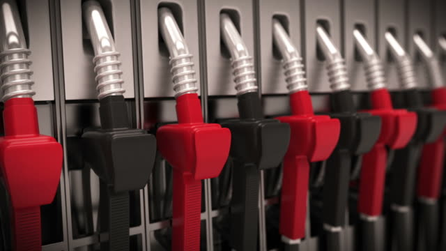 Gasoline oil pump nozzles at petrol station. Loopable CG. video