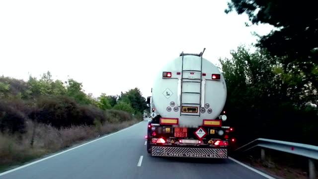 gasoline tanker, oil trailer, truck on rural road - nave cisterna video stock e b–roll