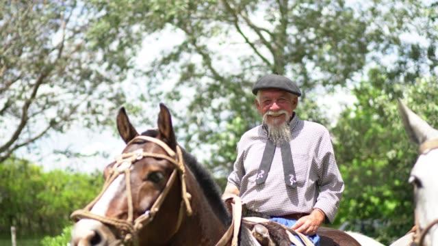 Gauchos riding horses