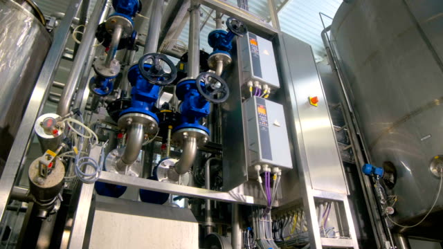 Gauges, valves and faucets at industrial factory. Shot in motion. video