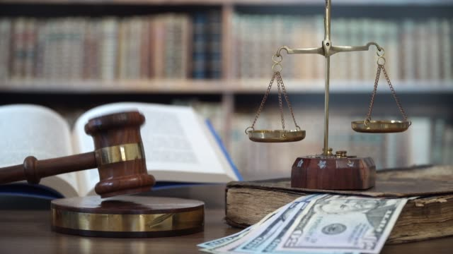 Gavel of the judge in the courtroom with dollar bills video
