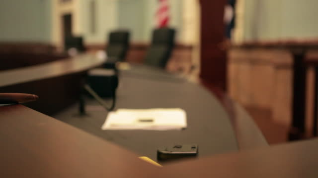 Gavel Sits On Judge's Bench In Courtroom – Dolly Shot A dolly shot reveals a gavel sitting on a judge's bench in an appellate court courtroom. legal trial stock videos & royalty-free footage
