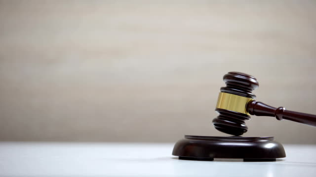 Gavel striking sound block against sold sign background, court decision, auction