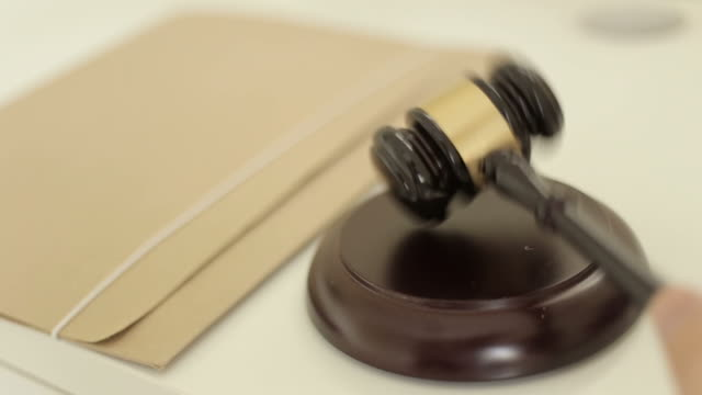 Gavel used by judge in court video