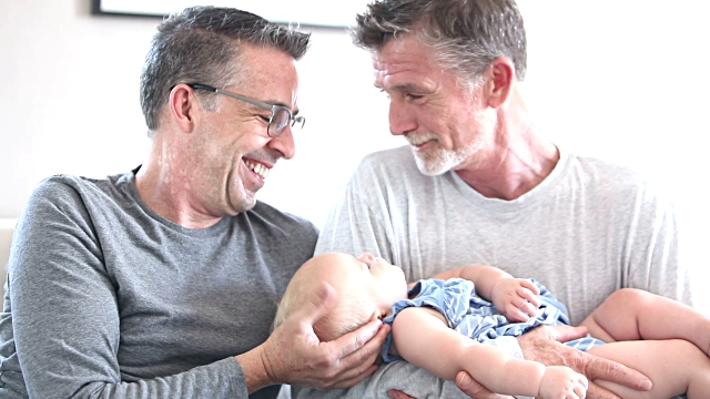 gay couple and a baby - same sex couples stock videos and b-roll footage