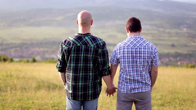 gay couple holding hands - same sex couples stock videos and b-roll footage