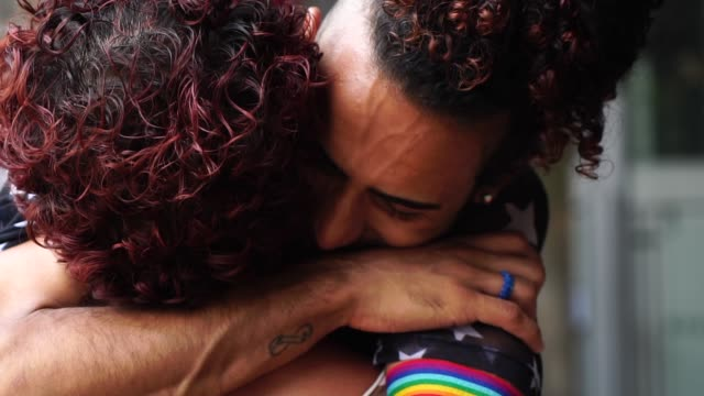 gay couple hugging after a long time without seeing each other - chiedere scusa video stock e b–roll
