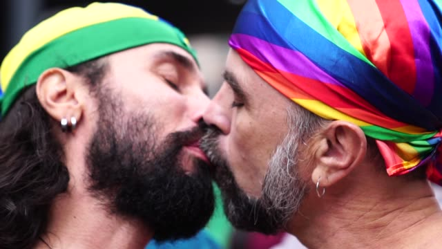 Gay couple kissing on Gay Parade Love is in the Air gay man stock videos & royalty-free footage