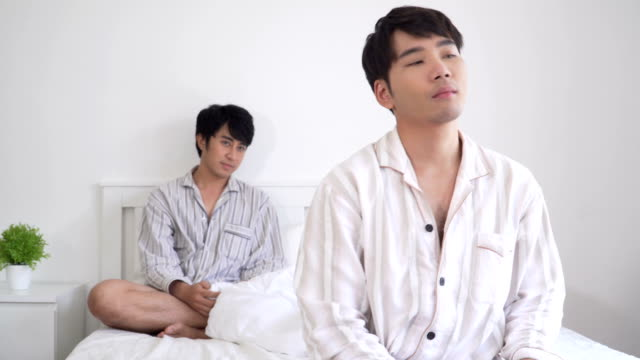 Gay Couple with argument on bed in morning Gay Couple with argument on bed in morning ignoring stock videos & royalty-free footage