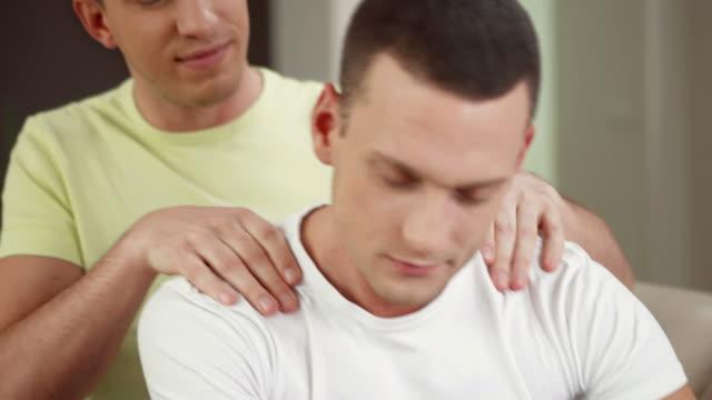 hd: gay man enjoying massage - massage stock videos & royalty-free footage