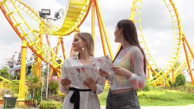Gay married couple at amusement park