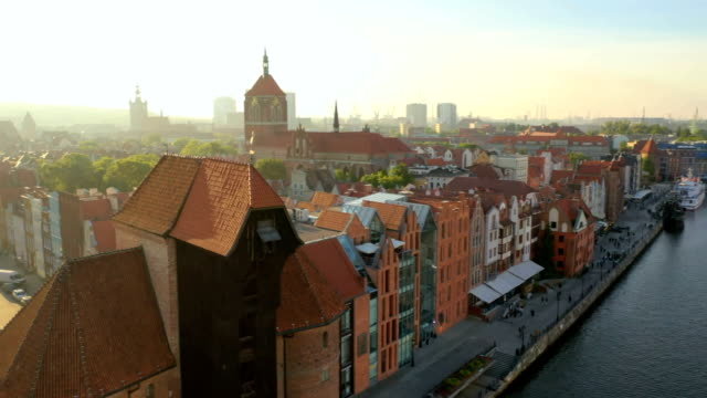 Gdansk, drone point view over the old city and old, medieval port crane. Aerial point of view, Gdansk old city. Motlawa river at sunset. Old mediaval crane. gdansk stock videos & royalty-free footage