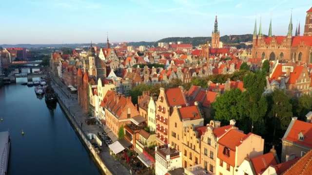 Gdansk old city in the rays of the rising sun, aerial view of the old city streets Gdansk old city in the rays of the rising sun, top view of the old city streets. 4K video gdansk stock videos & royalty-free footage