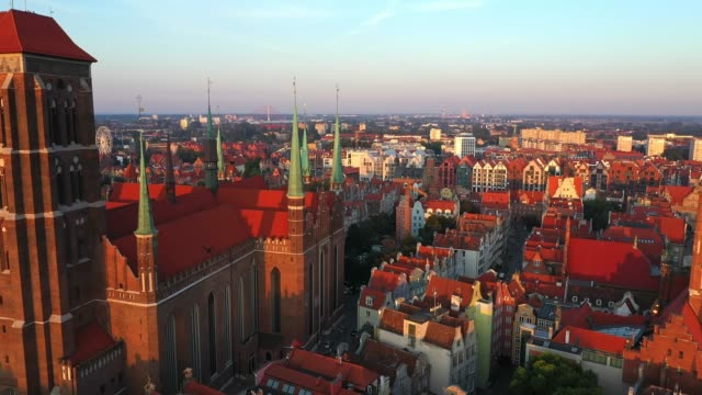 Gdansk, Poland. Aerial 4K reveal video of old city, Motlawa river and famous monuments: Gothic St Mary church, city hall tower, the oldest medieval port crane (Zuraw) and old houses Gdansk, Poland. Aerial 4K reveal video of old city, Motlawa river and famous monuments: Gothic St Mary church, city hall tower, the oldest medieval port crane (Zuraw) and old houses neo gothic architecture stock videos & royalty-free footage