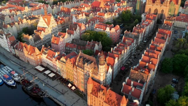 Gdansk, Poland. Flying over Gdansk old town at sunrise. Aerial drone shot. Gdansk, Poland. Flying over Gdansk old town at sunrise. Aerial drone shot. gdansk stock videos & royalty-free footage