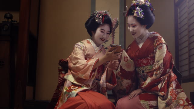 Geisha Maiko Using Mobile  UHD 4K video