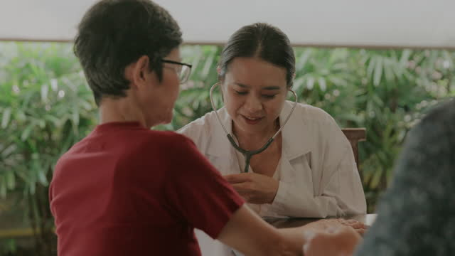 General Practitioner, Medical consult at home service-stock video Test results, medicare, doctor, patient,Thai Geriatrist doctor examining patients at home,Geriatrics examine at home, general practitioner stock videos & royalty-free footage
