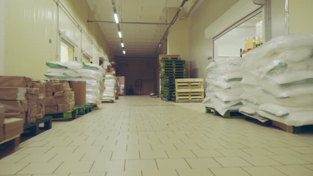 general view of the warehouse with boxes and furniture. moving between palettes with goods and materials at warehouse