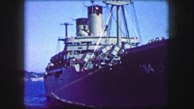 1944: USS General William Mitchell (AP-114) troopship turning docked. video