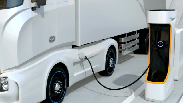 generic design blue heavy electric trucks charging at public charging station. the charging station - carica elettricità video stock e b–roll