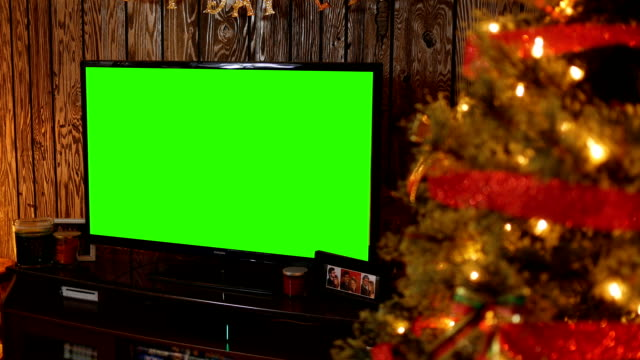 generic green screen tv in living room around christmas time - christmas movie video stock e b–roll