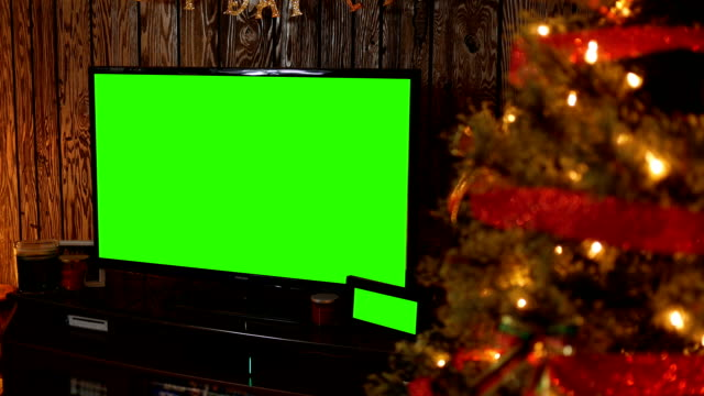generic green screen tv in living room with green picture around christmas time - christmas movie video stock e b–roll