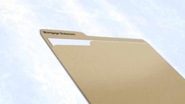 generic manila folder series - mortgage statements - schedario documento video stock e b–roll