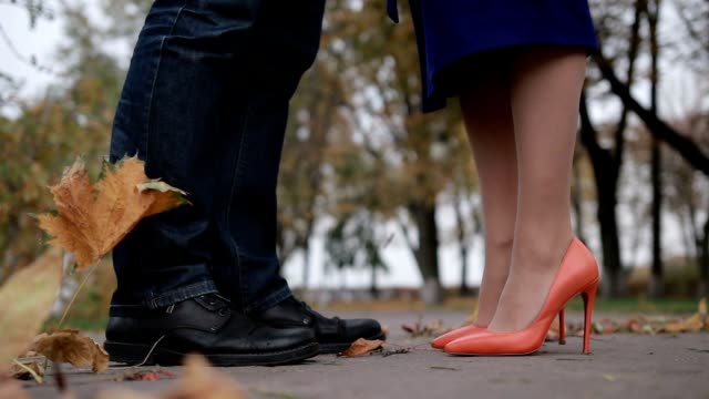 Gentle kiss of young romantic couple in autumn day video