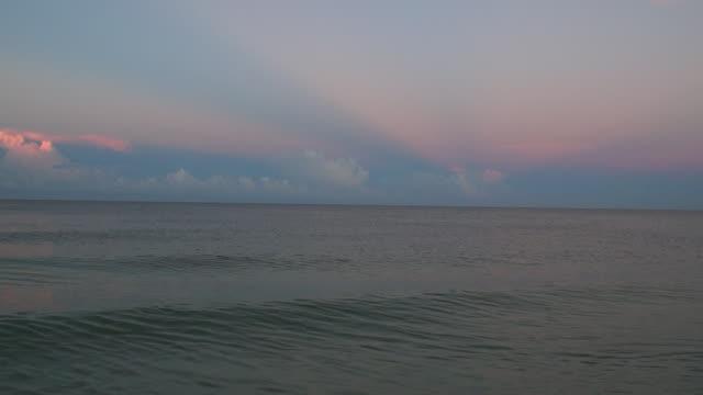 mjuka vågor med ljud - pink sunrise bildbanksvideor och videomaterial från bakom kulisserna