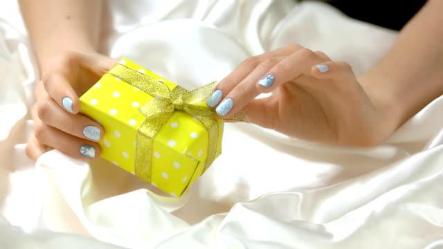 gentle winter manicure and gift box. - nastro per capelli video stock e b–roll
