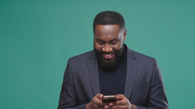 Gentleman holds smartphone in hands and writes text message