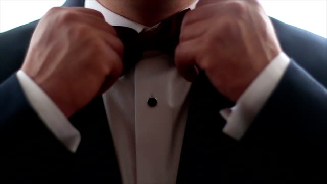 Gentleman Straightens His Bowtie video