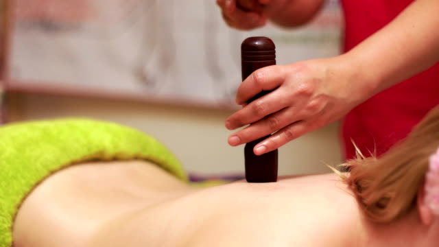 Genuine Thai Massage Studio Thai woman enterpreneur massaging a client in Tok-Sen style massage oil stock videos & royalty-free footage