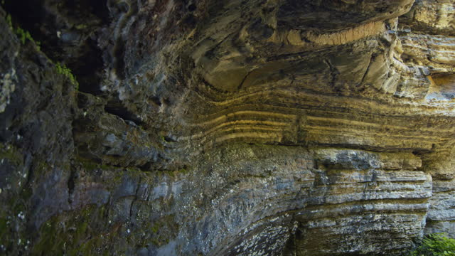 Geological rocks vaulted cavern /Grotte des fees /Saint-Leandre /Matane /Pan Geologic formation in shape of dome in lined rock half cave rock formations stock videos & royalty-free footage