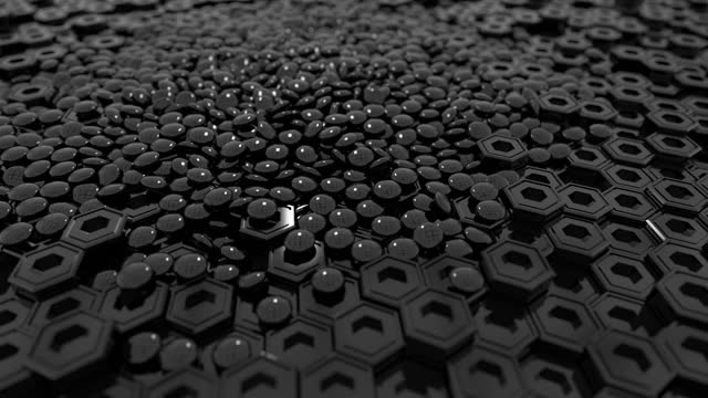 Geometric shapes abstract background. Hexagonal pillars and oblate spheres move in a chaotic flow. Wide-angle camera and panning shooting video. Black theme.