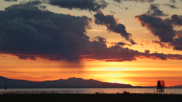 Georgia Strait Sunset, Richmond, BC Sunset looking across Georgia Strait at the Gulf Islands and Vancouver Island in the distance. British Columbia, Canada. fraser river stock videos & royalty-free footage