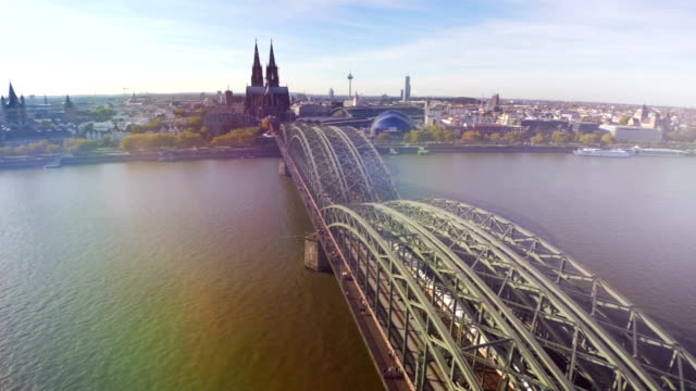 German city Koln or Cologne aerial, famous landmarks railway bridge, Opera, and Cathedral. Well-known attraction for tourists from all over the world. Beautiful German city view from above, lens flare video