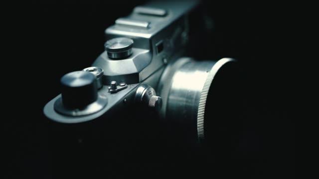 german classic vintage camera, black background, - analogico video stock e b–roll