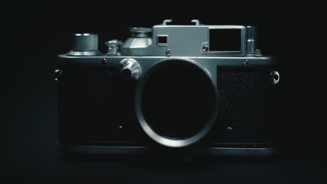 german classic vintage camera, black background, - analogiczny filmów i materiałów b-roll