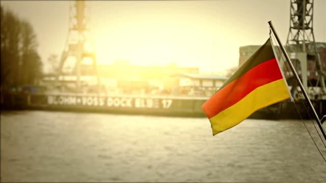 German flag at the harbor of Hamburg and Elbe river video